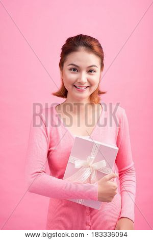 Sweet asian young woman holding gift on link background.