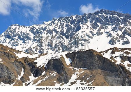 mountain massif with snow under bleu sky  in spring
