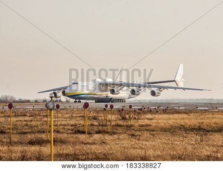 Kiev Region Ukraine - January 5 2012: Antonov An-225 Mriya cargo plane is taxiing on the runway for takeoff on sunset