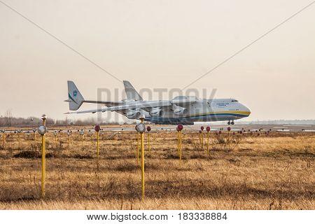 Kiev Region Ukraine - January 5 2012: Antonov An-225 Mriya cargo plane is taxiing on the runway for takeoff on winter sunset