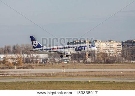Borispol Ukraine - November 13 2010: LOT Airlines Embraer ERJ-170-200LR passenger plane is landing on the runway in the airport