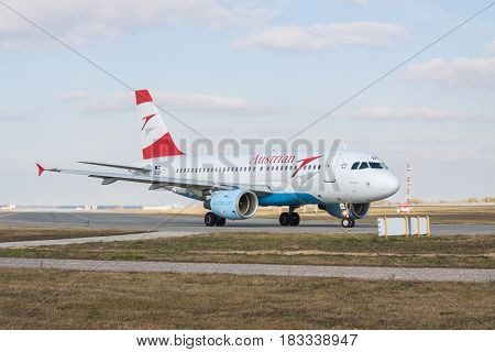 Borispol Ukraine - October 23 2011: Austrian Airlines Airbus A319-112 taxiing to the runway in the airport for takeoff on a cloudy autumn day