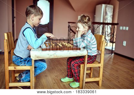 two children playing in checkers at kindergarten