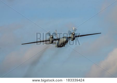 Kiev Region Ukraine - January 5 2012: Iraqi Air Force An-32 cargo plane in flight with blue sky on sunset