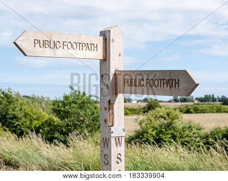 Public footpath sign in the UK giving directions of the path.