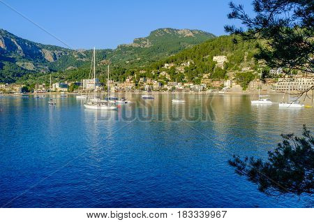 Boats moored in the evening sun in the harbour at Port De Soller Majorca Spain