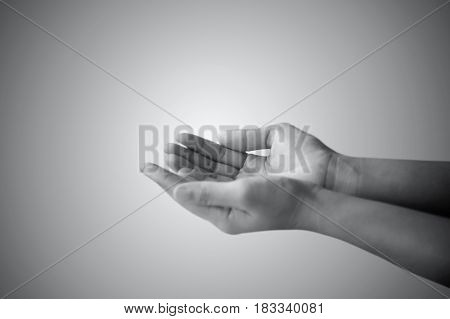 hand of man praying and asking in white and black