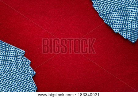 Cards over red felt. Abstract background with copy space. Gambling poker blackjack and casino theme