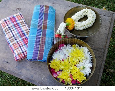 Traditional Thai In Songkran Day Bring Garland And Petal Flowers On Water In Brass Bowl With Loinclo