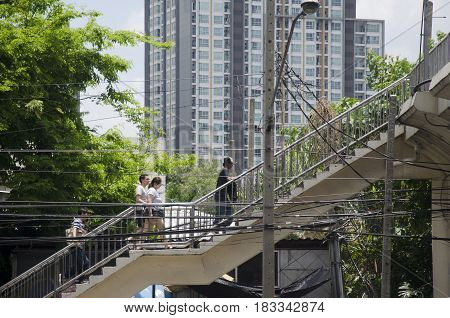 Asian Thai People And Foreigner Traveler Walking On Bridge Overpass Traffic Road Go To Travel And Sh