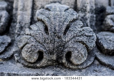 Stone carving on the vintage wall as a background.
