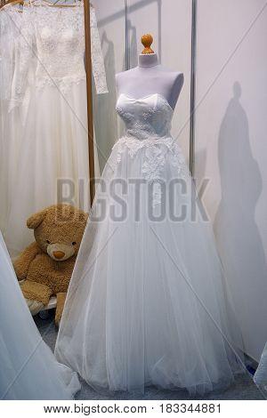 Elegant white wedding dress on a mannequin