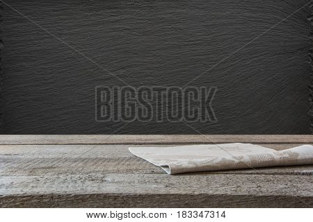 Kitchen abstract background. Empty wooden tabletop and black slate chalckboard for display or montage your products.