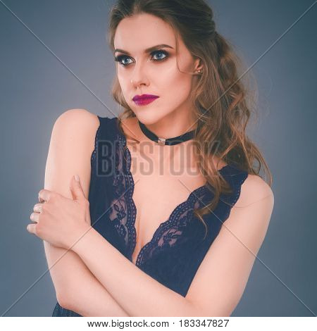Portrait of beautiful young woman face. Isolated on gray background.