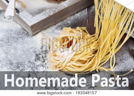 Raw homemade pasta on wooden background