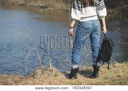 Woman Stands Near River, Soft Focus Background