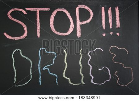 Conceptual stop sign narcotics colored chalk on a blackboard