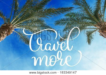 Two palm treetops against a sunny sky and Travel more text. Calligraphy lettering hand draw.