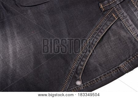 front pocket of dark jeans close up.