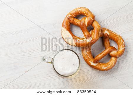 Lager beer and pretzel on wooden table. Top view with copy space
