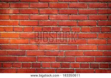 Old red brick wall close up. Grunge texture and background
