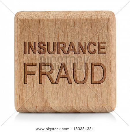 Wooden cube with text INSURANCE FRAUD on white background