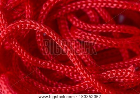 Red syntetic cord for handicraft macro close-up, blurred