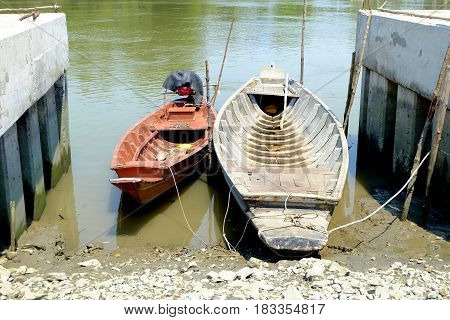 Two Long Tail Boats Beside The River.