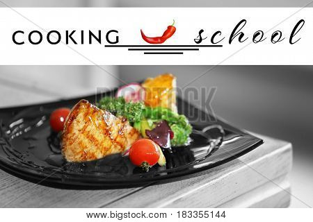 Plate of fried chicken fillet with vegetables on wooden background. Cooking school concept