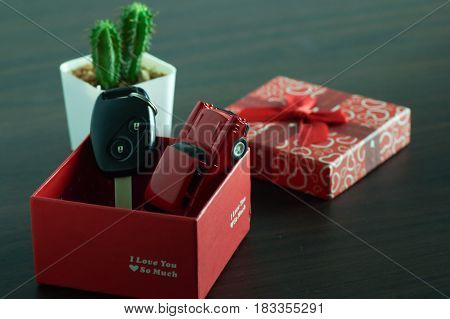 key of car with red gift box concept in loan buy and sell for present