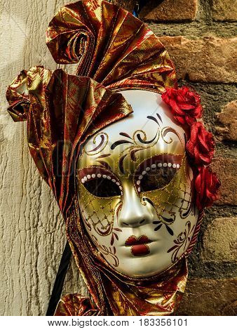 Handcrafted venetian mask suspended on the wall