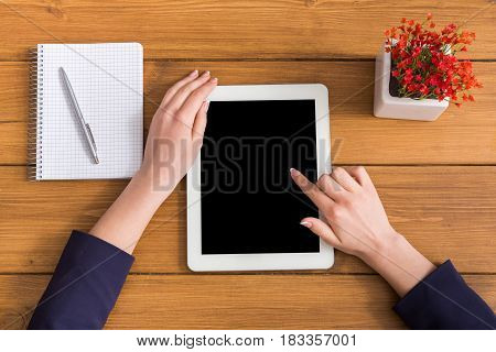 Top view businesswoman touch screen of tablet in office. Freelancer working with portable computer with copy space on display