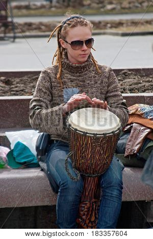 Volgograd Russia - April 03 2011: Portrait of woman plays the djembe drum in Volgograd