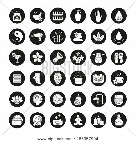 Spa salon icons set. Aroma therapy, stones massage, face cream jar, towels, flowers, foot file, cucumber mask, shower, candles, oil. Vector white silhouettes illustrations in black circles