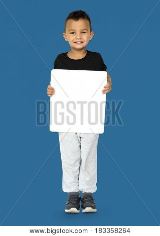 Little Boy Holding Blank Empty Paper Board Studio Portrait