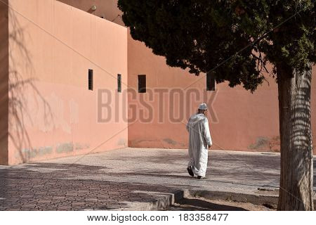 Muslim Arabic man walking in the road