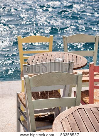 Table And Chairs By The Sea