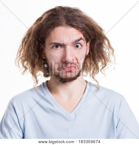 Negative human emotion. Man expressing unpleasant feelings on face, grimacing on white studio background, cutout