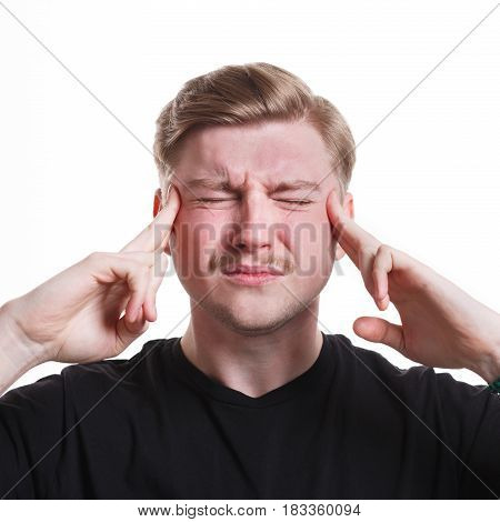 Under pressure. Concentrated tense stressed man, holding fingers on temple, white isolated studio background