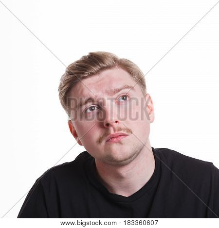 Lost in thoughts. Man with pensive thoughtful face looking away, thinking about something on white isolated studio background, portrait