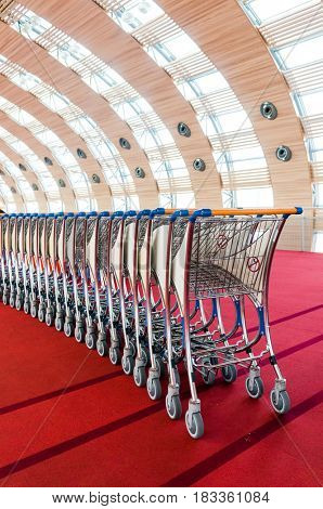 Paris, France, April 1, 2017: luggage carts at modern airport