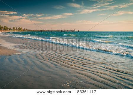 View at Glenelg Beach jetty with people on a warm day South Australia