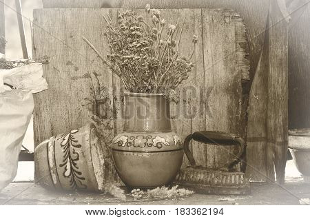 Vintage pots and iron with old background.Image with a feeling of abandonment and discarding