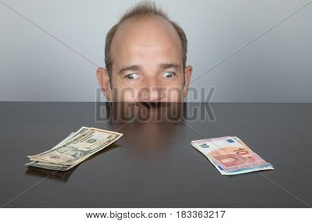 One Eye Looking At Dollar And Other At Euro Banknotes