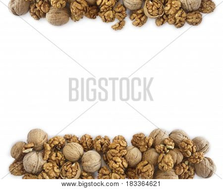 Walnuts background. Walnuts at border of image with copy space for text. Kernels walnuts on a white background. Top view. Vegetarian or healthy eating.