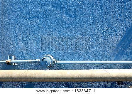 Old Pipes with Blue Cement Texture Wall Background.