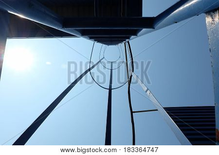 Fire Escape with Sun Flare on Blue Sky.