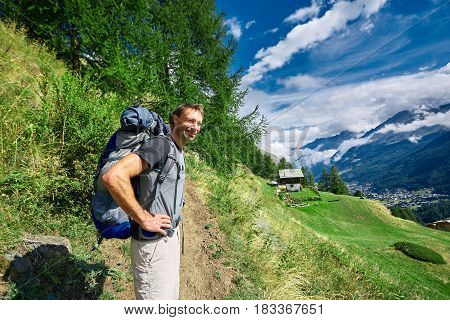 hiker on the trail in the the Apls mountains. Trek near Matterhorn mount.