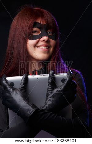 Smiling thief in black gloves