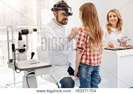 I will do some tests. Nice pretty teenage girl paying a visit to ophthalmologist who running some tests and studying her eyesight